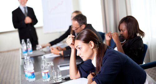 training / board room/ meeting room image of staff bored